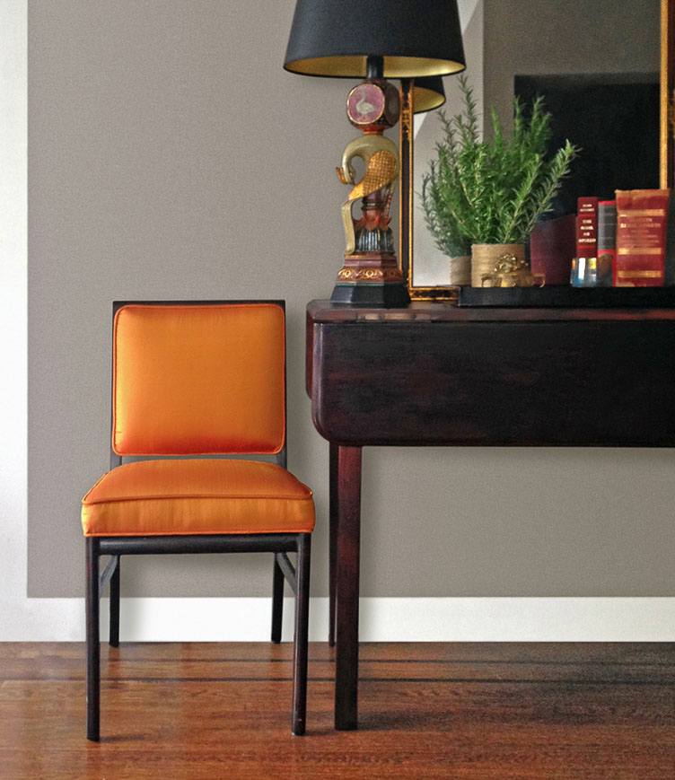 Revitaliste reupholstered these Timeless Accent Chairs in orange shantung silk sourced from Asia and the wood frames were refinished in a dark mahogany stain with a satin sheen.