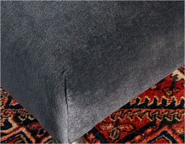 Revitaliste reupholstered this ottoman in a plush charcoal grey mohair fabric.