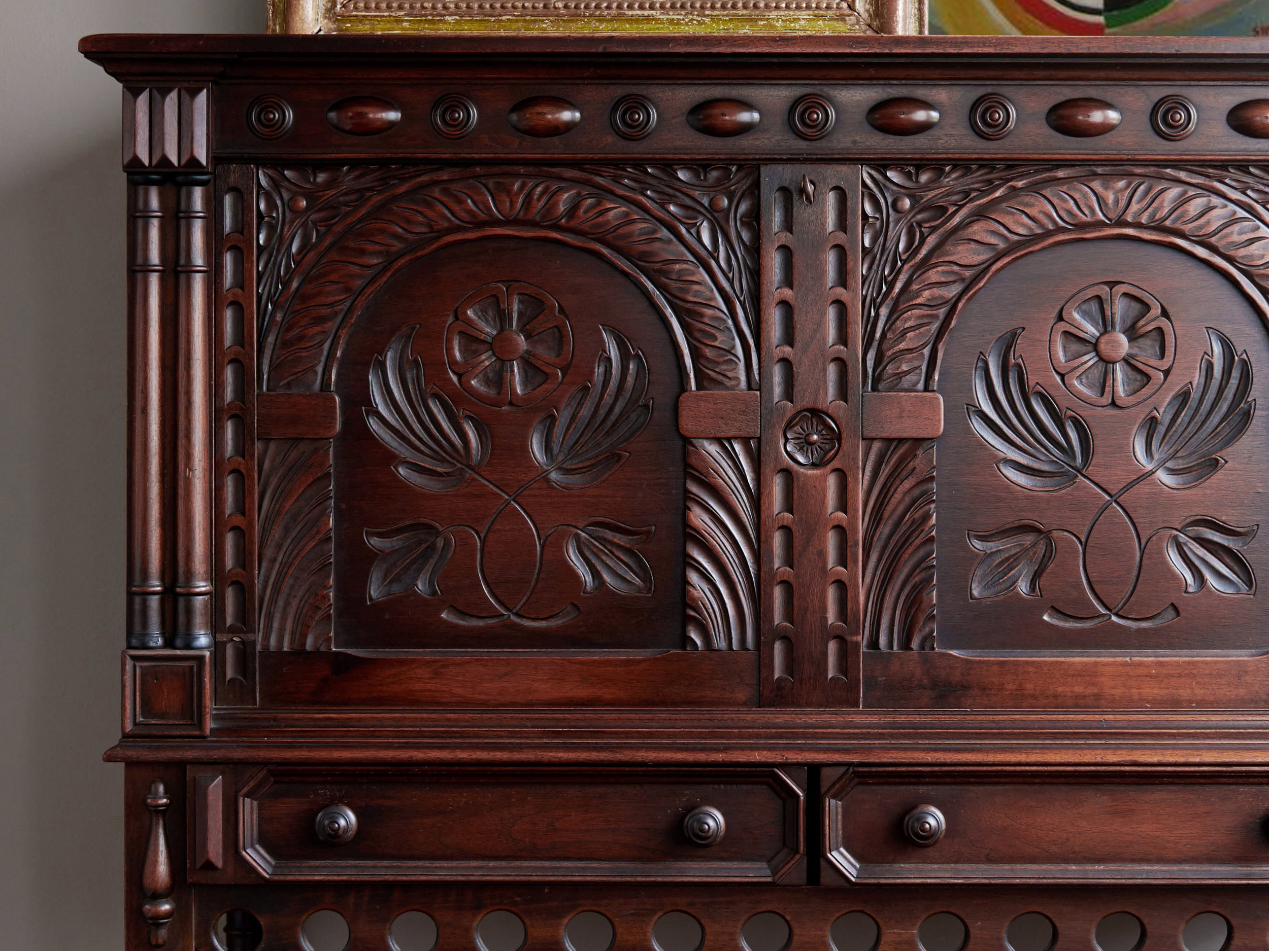 Revitaliste refinished the Antique Secretary Desk in a dark mahogany wood stain, replaced the carved details and repaired the drawer glides.