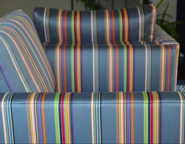 Revitaliste upholstered these Milo Baughman Club Chairs in Paul Smith for Maharam upholstery fabric.