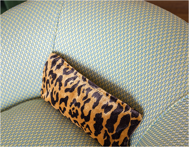 Revitaliste reupholstered these Swivel Barrel Chairs in a green, geometric upholstery fabric from Pierre Frey.