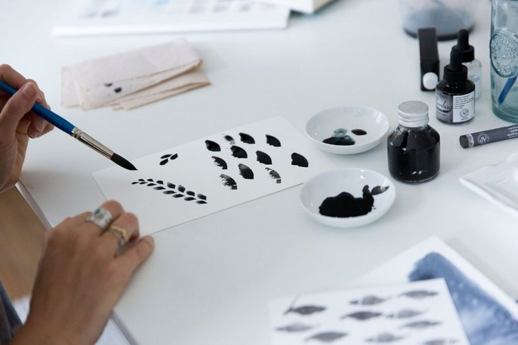 Kate in her studio designing new patterns.