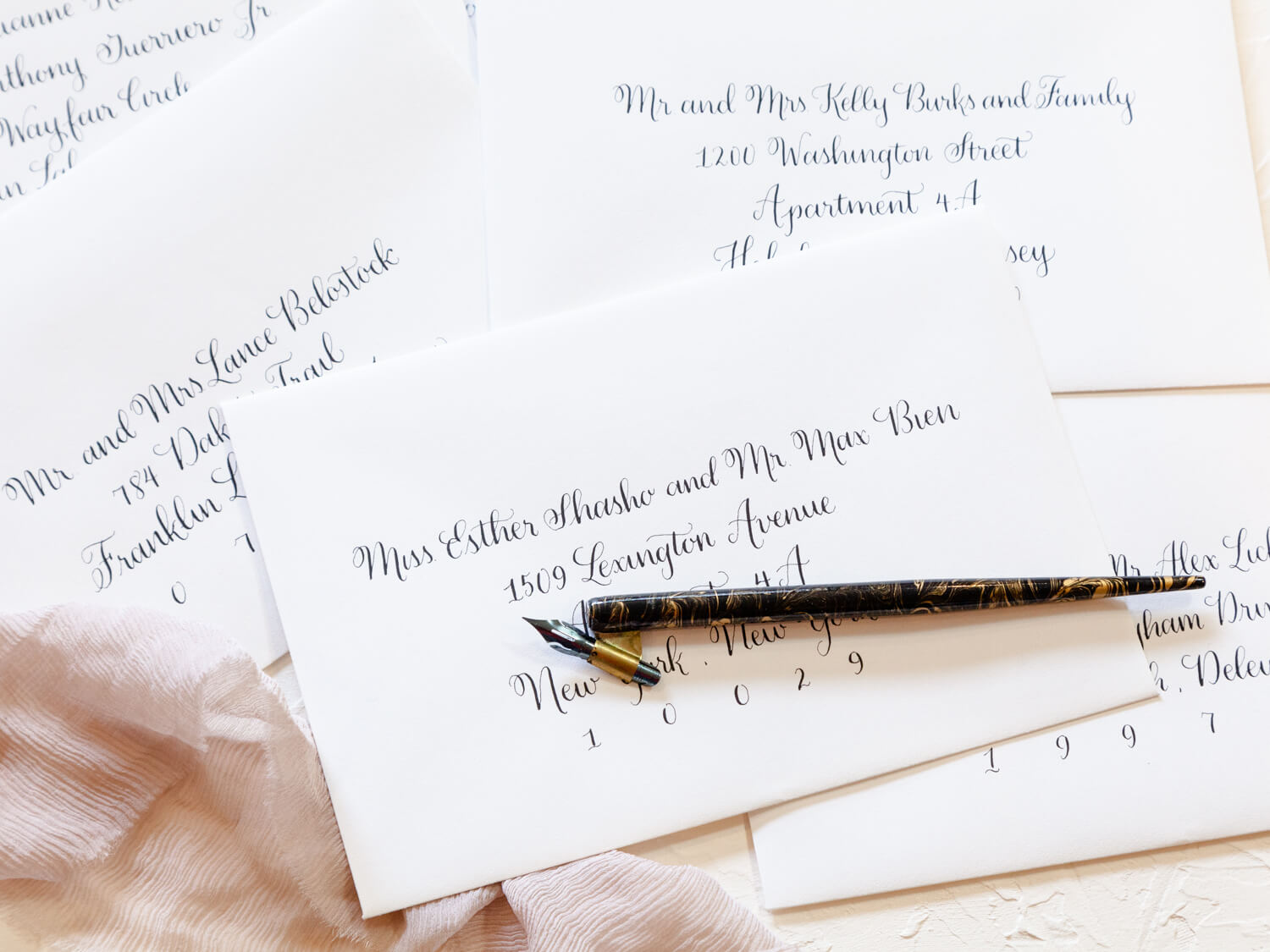 Calligraphy - We offer professional hand calligraphy for envelope addressing and place cards. Calligraphy gives each envelope a personal, handwritten feel, giving your guests a warm welcoming from the very first moment.