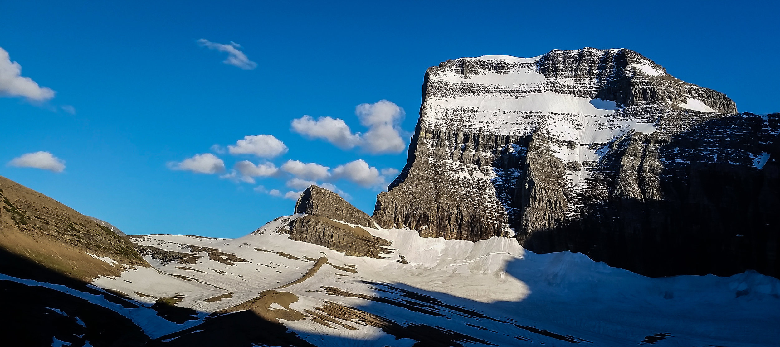 Mt Gould, with the edges of Grinnell Glacier creeping up the sides.