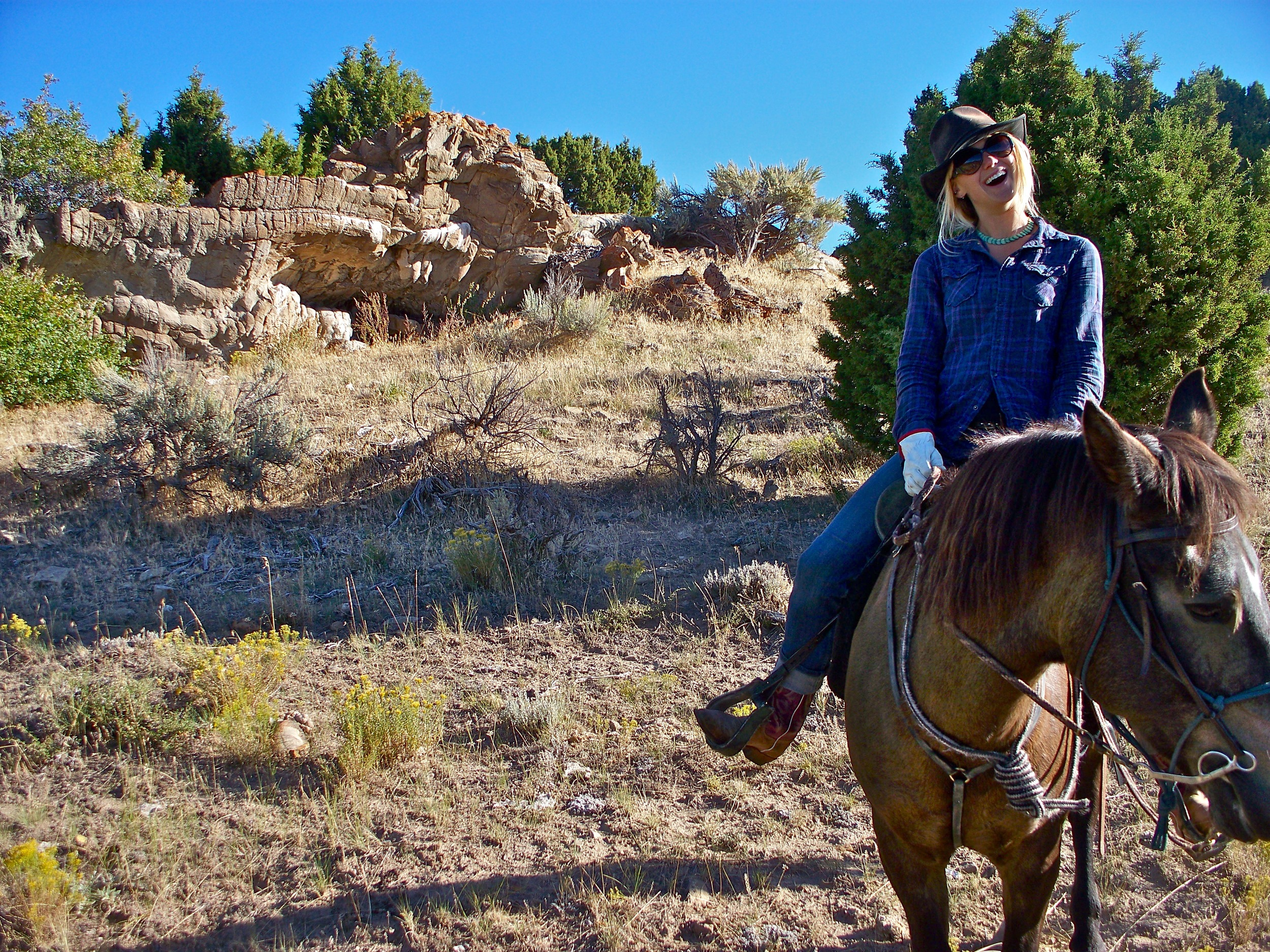 Liz while working on a horse ranch.