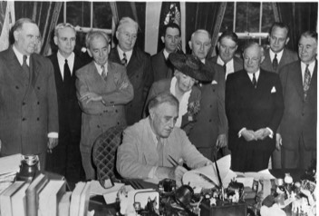 "photo, left, President Roosevelt signing ""G.I. Bill,"" courtesy of FDR Library"