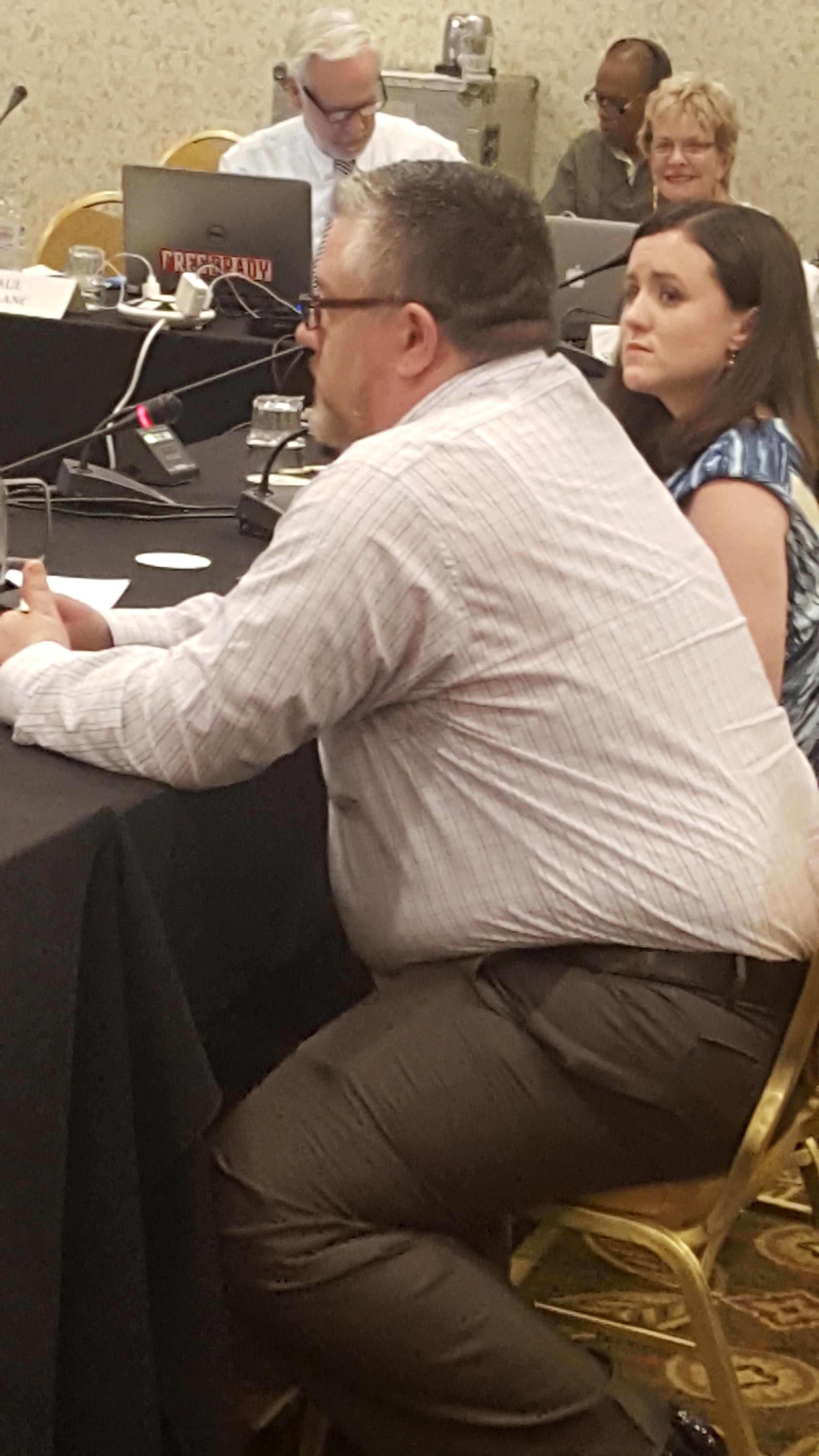 Matt Mitchell, a student veteran, and Sara nolan collins, legal services director, testify at naciqi meeting concerning acics accreditation
