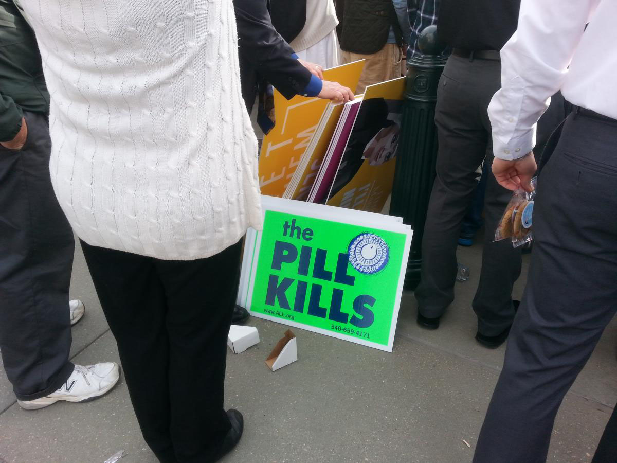 Anti-birth control activists protest outside the U.S. Supreme Court
