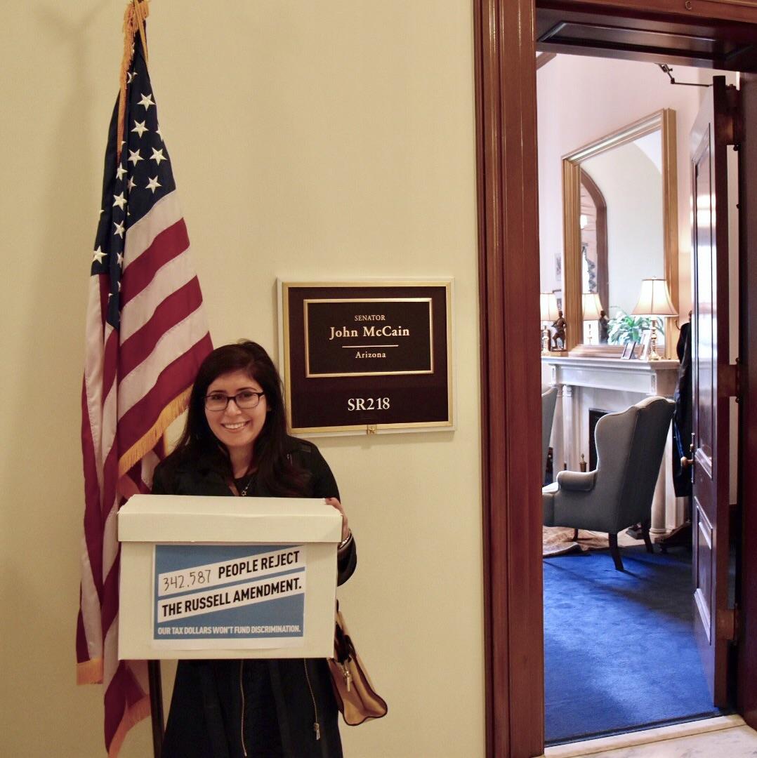Americans United's Legislative Assistant Samanatha Sokol delivering petitions.
