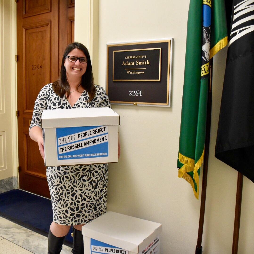 Americans United's Legislative Director Maggie Garrett delivering petitions.