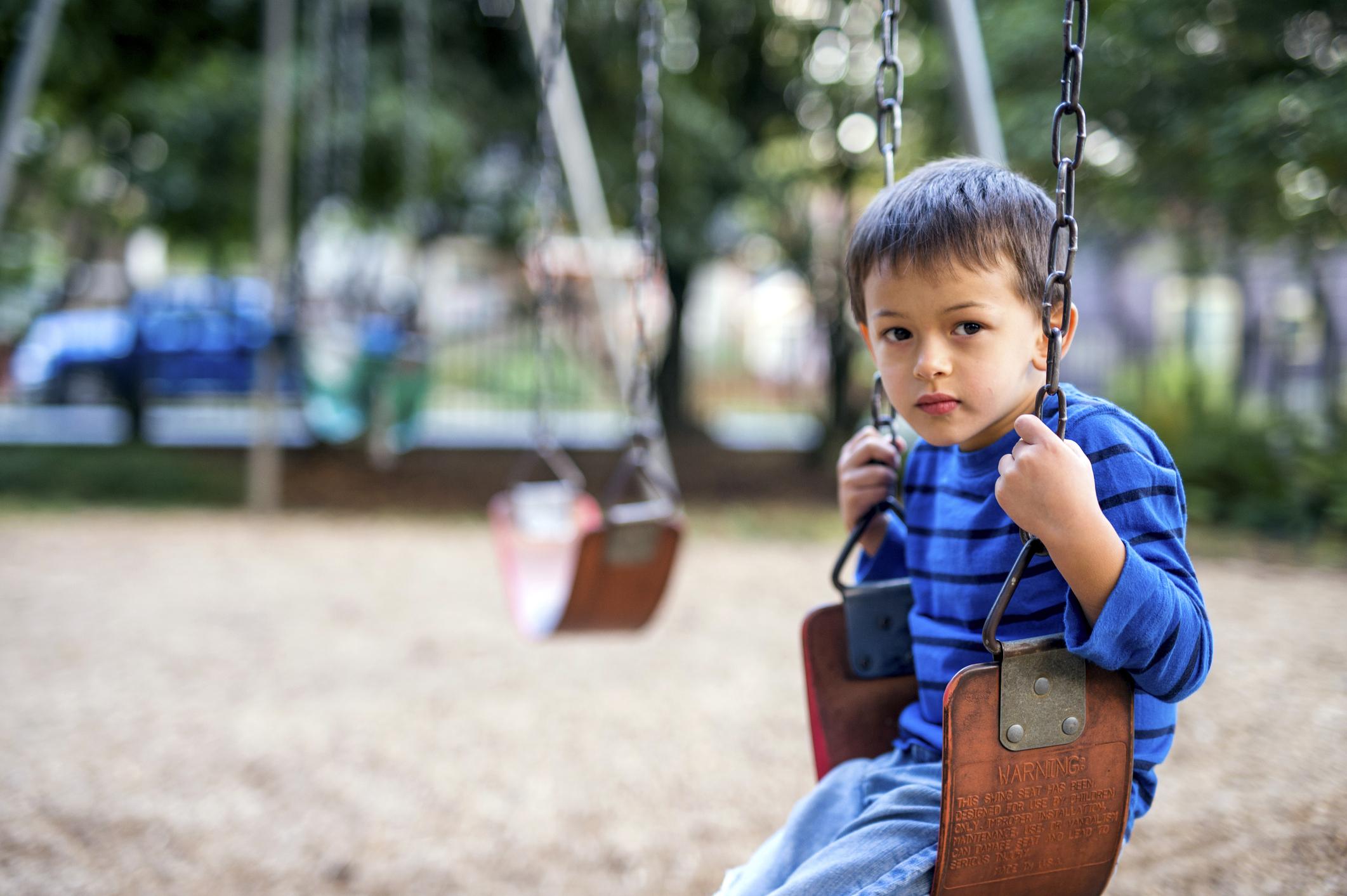 sad_kid_on_swing 2.jpg