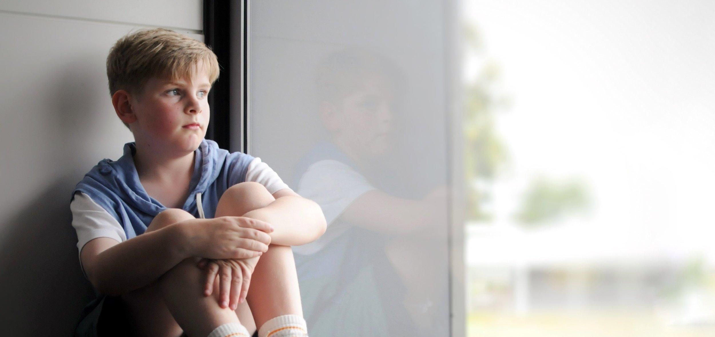 sad_boy_cropped_mirror.jpg