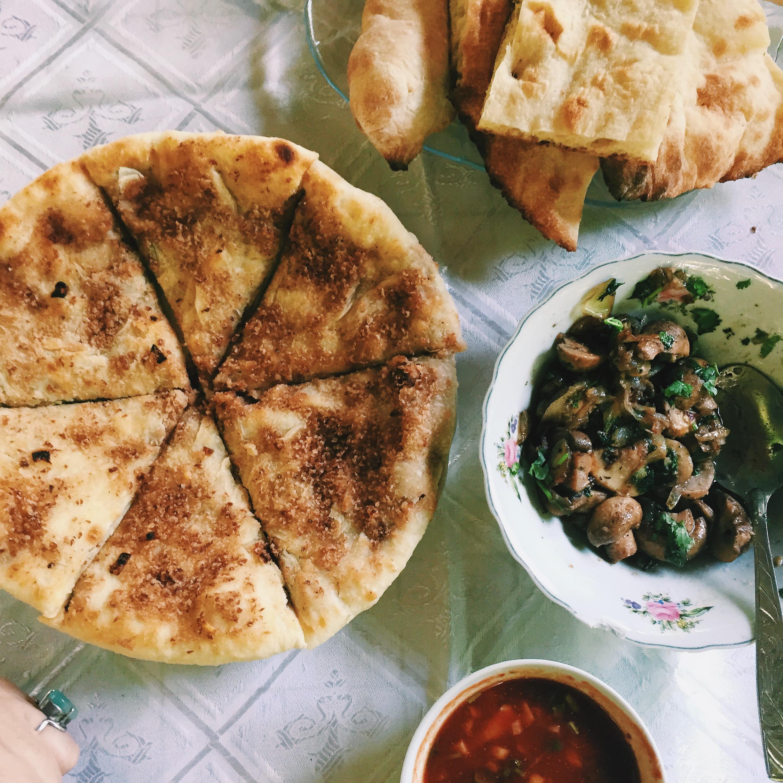 Lobiani khatchapuri  (bean filled bread), soko  (sautéed mushrooms with onions and herbs), and   satsabeli    (spicy fresh tomato sauce).