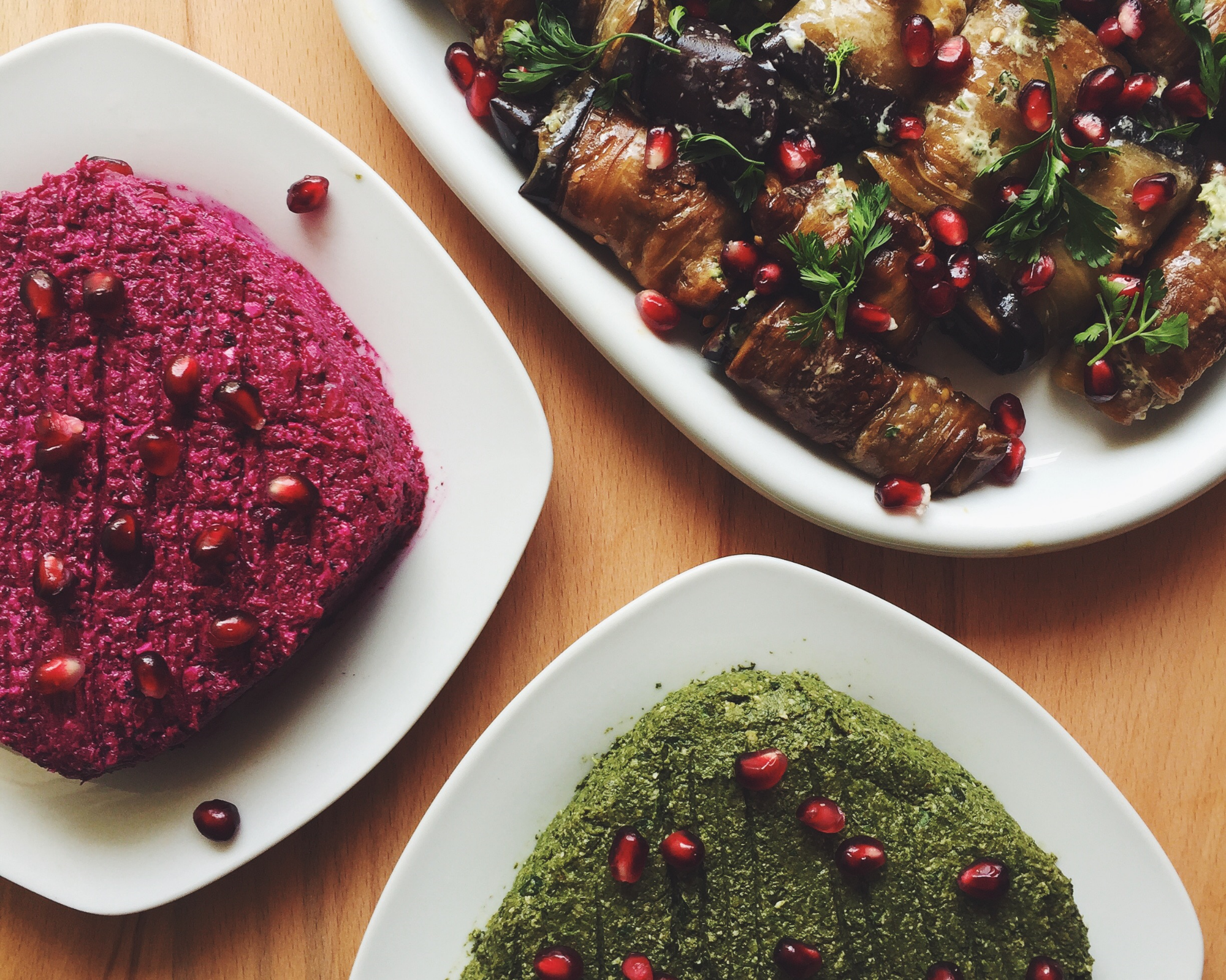 Beet and spinach  pkhali , a type of Georgian vegetable pate, along with  badrijani-nigvzit , fried eggplant rolls with a walnut-garlic filling.
