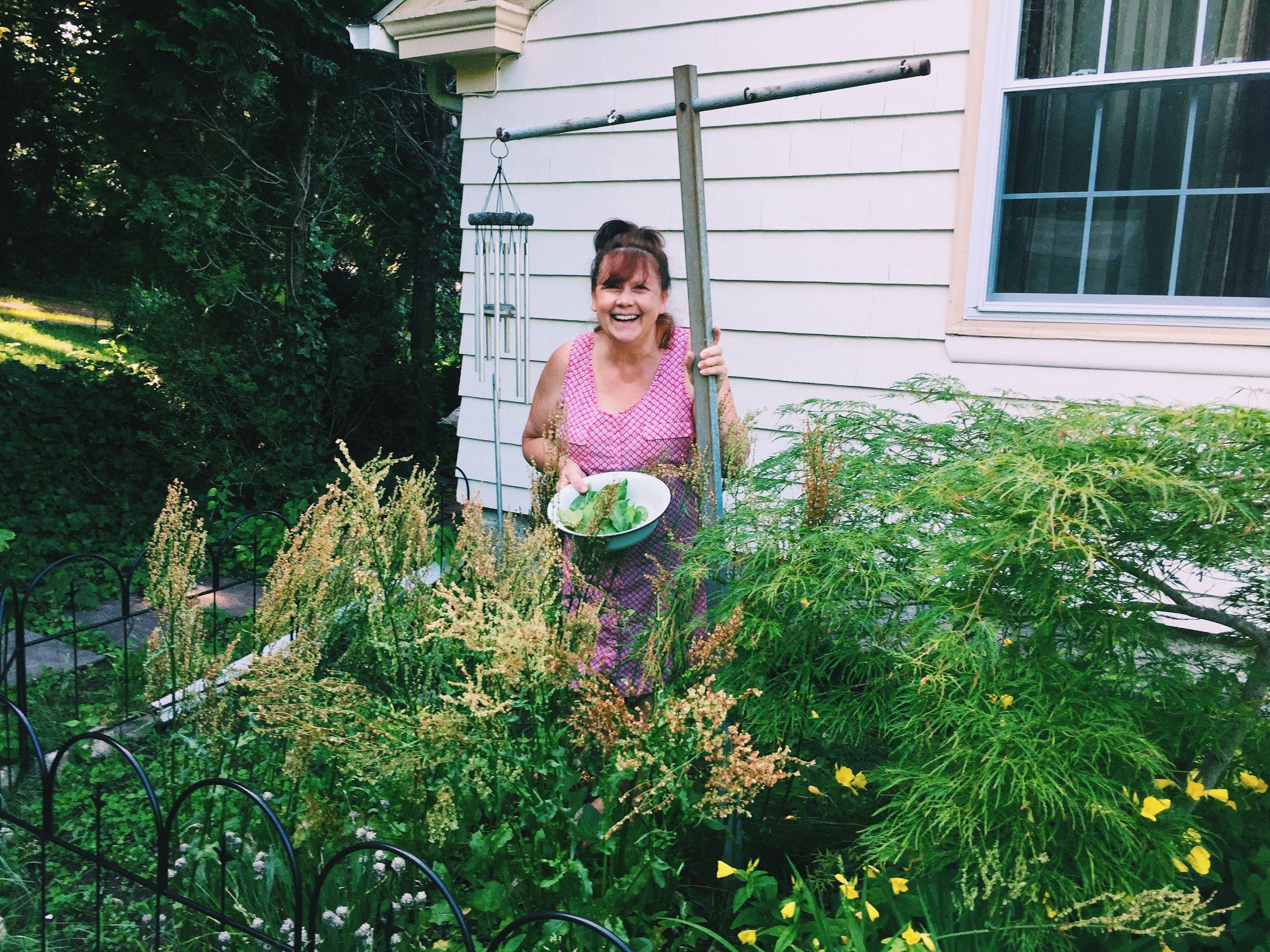 My Aunt Olga picking sorrel from her garden.