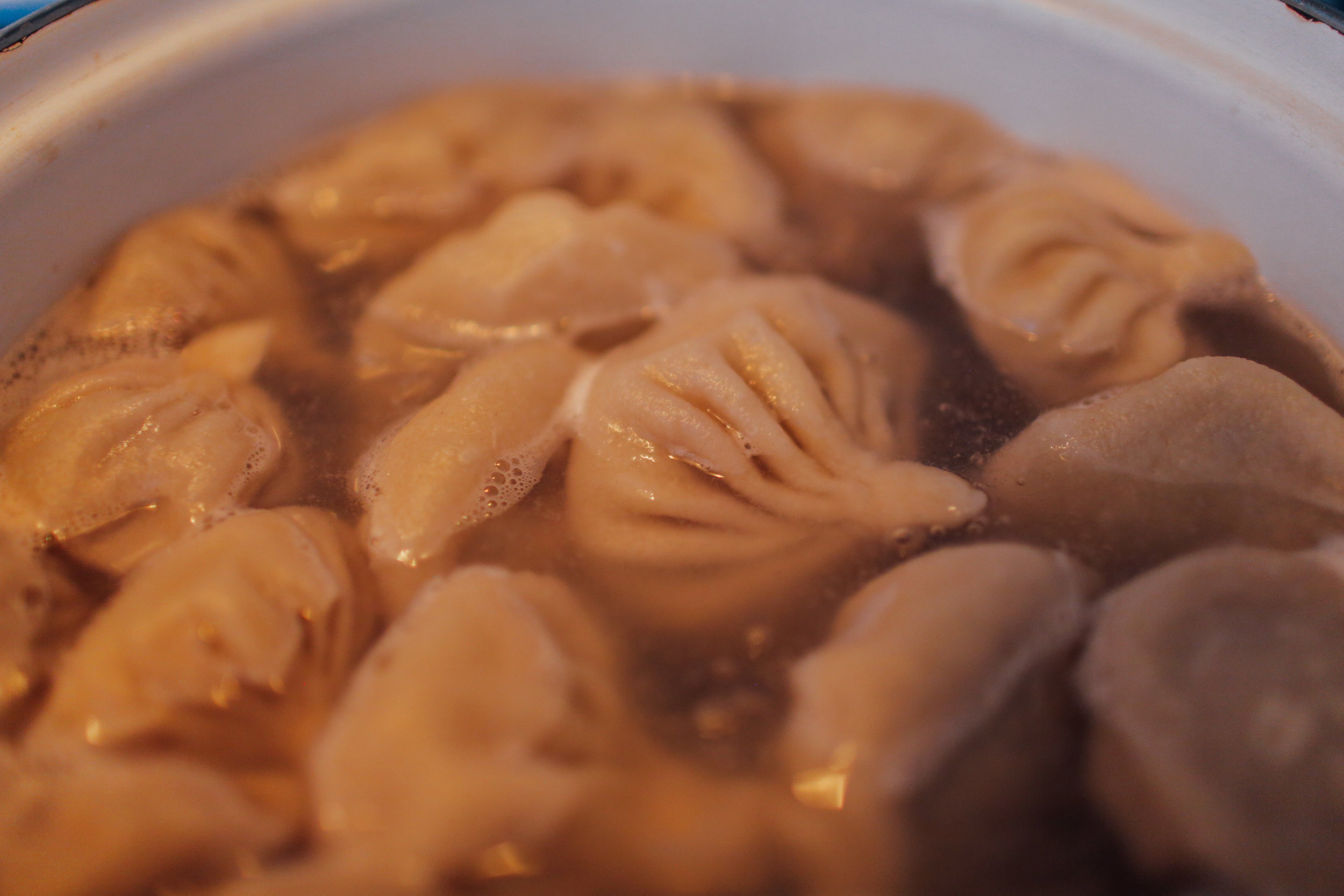 19. Add dumplings to boiling water, bring to a simmer again, and cook for 10-12 minutes.