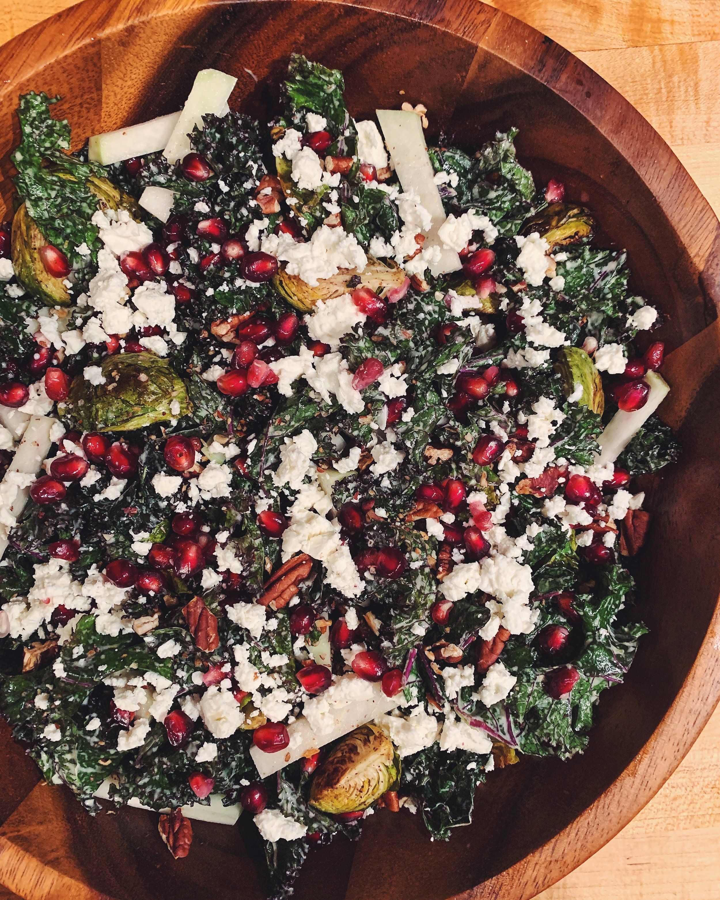 Kale Salad with Roasted Brussels Sprouts, Kohlrabi, & Pomegranates with Lemon Tahini Dressing