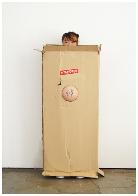 Belly Box , 2016, found cardboard and body