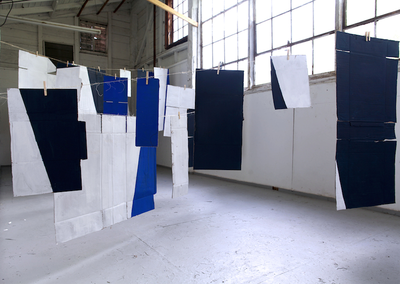 Dirty Laundry , 2015, used cardboard, paint, string and clothes pins, Room 23x11,5 ft