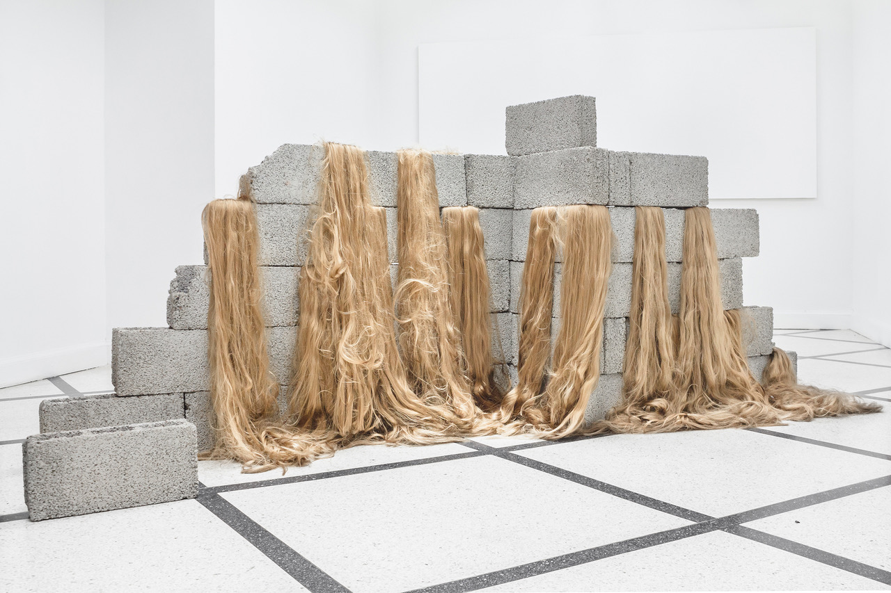Sad wall, 2018,  concrete blocks, synthetic hair,  dimensions variable