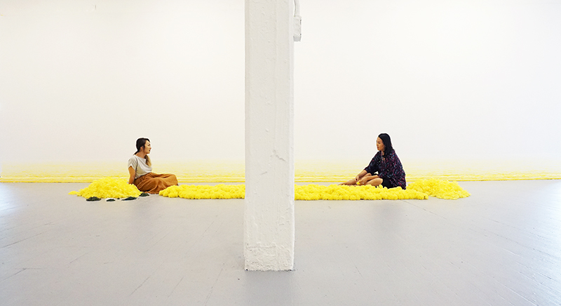 "Loving Deeply I, 2018 / East Hall Gallery, Pratt Institute, Brooklyn, NY / 7 Days Performance Yellow Silk Flowers, 300"" x 72"" (Gallery View)"
