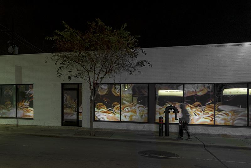 "Allison Hunter, installation view, ""Hive,"" 2018, 3-channel public facing video installation, Houston, TX."