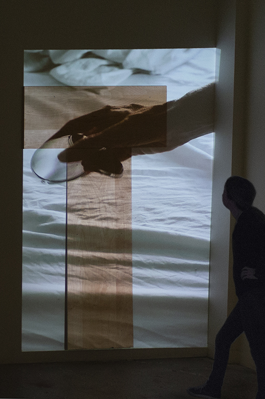 """Allison Hunter, installation view, """"Compact,"""" 2017, single-channel video installation with wood form, SVA Open Studios, New York, NY."""