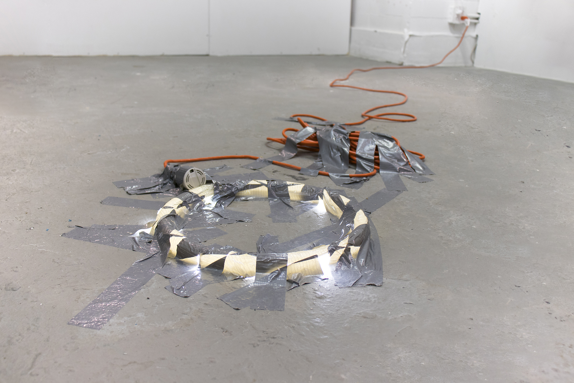 Bat-Ami Rivlin,  Untitled (DUCT TAPE, LED, CORD, BALLAST) , 2019. Duct tape, LED circular light bulb, extension cord, ballast. Image courtesy of the artist.