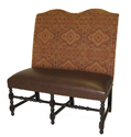 Barcelona   Designer Banquette    Displayed  In: Patterned Fabric and Brown Leather   Dimensions:   L: 45″  D: 26″  H: 48″   Custom sizes & fabrics   are always available.   Spun wood legs and nail heads bring out just the right amount of detail. The tall curved back adds to the Barcelona's dramatic presence and would look great in your Latin inspired dining area.