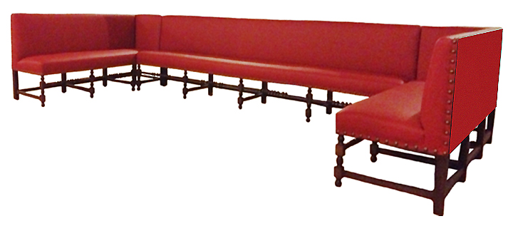 Barcelona   Designer Banquette    Displayed  In: Red Vinyl Turned Wood Legs   Dimensions:   W: Customizable  D: 26″  H: 36″ Bar Height and Counter Height perfect for your bar areas where food is served  *See The Matching Chair   *Back To Designer Banquettes  The Barcelona banquette is a taste of  Mediterranean style.  Custom turned wood legs can be stained in a variety of colors to suit your color scheme.  Bold antique brass nailhead detailing provides the perfect tasteful accent.