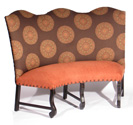 Baroness   Designer Banquette    Displayed  In: Patterned Fabric and Apricot Velvet   Dimensions:   L: 45″  D: 26″  H: 48″   Custom sizes & fabrics   are always available.   The banquette's curved legs and nail heads add just the right amount of detail. A few of these in your restaurant along with the tall curved back adds to the Baroness' dramatic presence in your dining area.