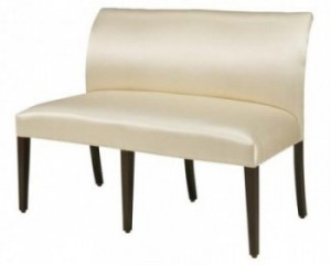 Fargo   Designer Banquette   Displayed  In: White Pearlized Vinyl and Espresso Stained Wood Base and Legs   Dimensions:   W: 50″  D: 26″  H: 36″   Available in custom sizes & fabrics.   *See Matching Side Chair  The Fargo Banquette is the epitome of fine tailoring and sophistication with its gently arched back and tapered legs for ensemble restaurant seating.