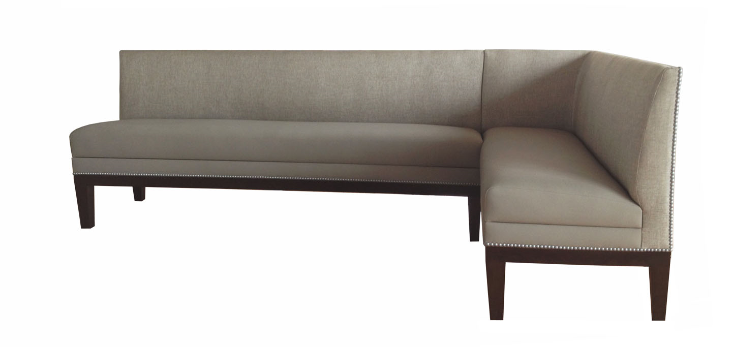 Jackson Designer Banquette   Displayed  In: Kravet Kolam, Color: Breeze and Allante Shale Faux Leather Dark Walnut Wood Border and Tapered Wood Legs   Dimensions:   W: 56L x 97″L (customizable)  D: 26″  H: 34″   Available in custom sizes & fabrics.   The addition of the Old-Silver nail-head detail  accentuates the sleek styling of this Banquette and will do the same for your restaurants decor.