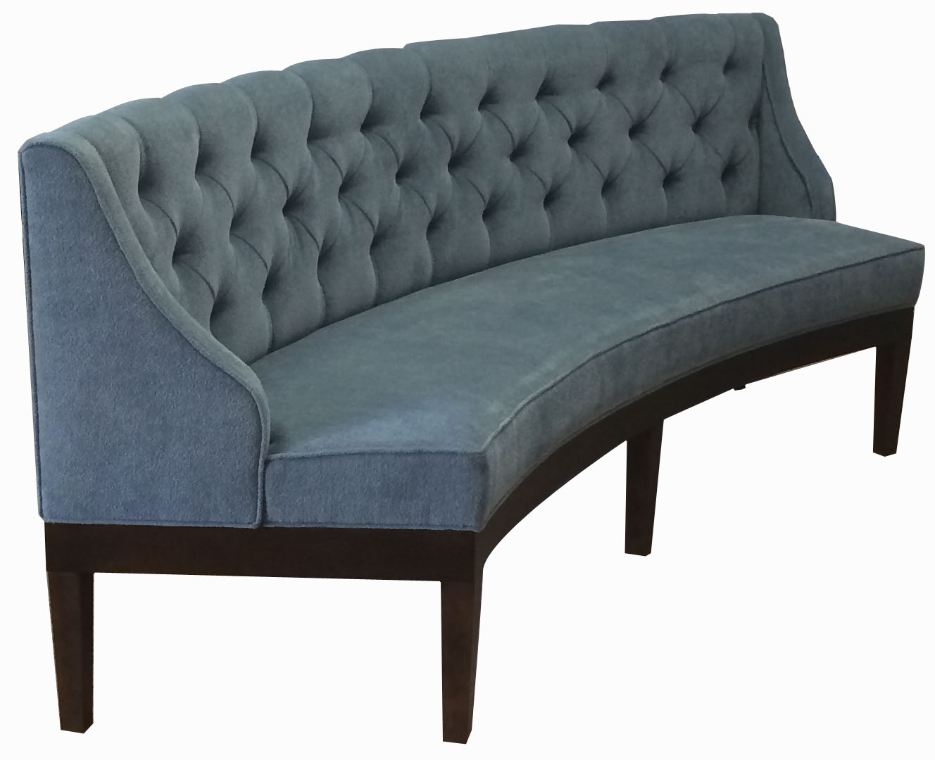 Riley Designer Banquette  Displayed In: 100% Polyester Stain Resistant Velvet   Dimensions:   L: 92″  D: 24″  H: 34″   Available in custom sizes & fabrics.    This beautiful piece of custom crafted restaurant furniture is perfect if floating in the middle of your dining room, displaying a smooth a elegant curved upholstered back.