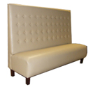 Nola Designer Banquette   As Displayed: Beige Vinyl   Dimensions:   L: 72″  D: 23″  H: 50″   Available in custom sizes & fabrics .  This custom banquette combines its tapered wood legs with a creamy neutral  luxury vinyl upholstery.   Designed to fit into tight space in your restaurant and still show-off dramatically high back..