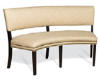 Newton Designer Banquette   As Displayed : Tanous Sand with Natural Brass Nails Wood Finish: Espresso   Dimensions:   W: 65″  D: 30 1/2″  H: 37-1/2″   Available in custom sizes & fabrics  .   * Matching Pieces  This Curved Designer Banquette has tall legs that lighten and contemporize  the look and feel and the open styling creates airy sophisticated look.   Available as a straight backed banquette.