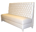 Nichols Designer Banquette  As Displayed: Empress Pear Vinyl on back and Allure Winter While Vinyl on seat,  White legs   Dimensions:   W: 76″  D: 26″  H: 48″   Available in custom sizes & fabrics  .   This custom banquette is luxurious in pure white with tapered legs, an its diamond-tufted button-back with welt detail will command the attention of your restaurant patrons.