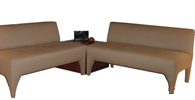 Peck Designer Banquette As Displayed  : Tan Leather   Dimensions:   L: 88″  D: 26″  H: 32″   Available in custom sizes & fabrics  .      This sleek modern designer banquette has legs that flow. This fully upholstered stylish masterpiece of craftsmanship and design will have your restaurant guests talking!.