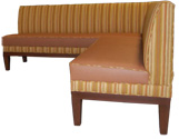 Ginger Designer Banquette   Displayed  In: Orange Stripe, Ginger Vinyl and Walnut Finish   Dimensions:   W: 72″ X 72″  D: 26″  H: 32″   Available in custom sizes & fabrics.   Ginger's L-shape is convertible into two straight sections when rearranging your restaurant for private parties. A contrast-welt on the banquette's seat adds definition.