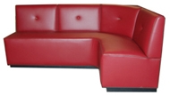 Tallemara Designer Banquette  As Displayed: Red Vinyl   Dimensions:   L: 72″ x 72″  D: 26″  H: 36″   Available in custom sizes & fabrics.   This custom design with the accent button in the perfect place, contrast welting provides some additional detail.