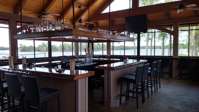 Inside New Pavilion with Hand Crafted Wood Bar & Floating Soffit after Raymonds Restaurant Designer magic.