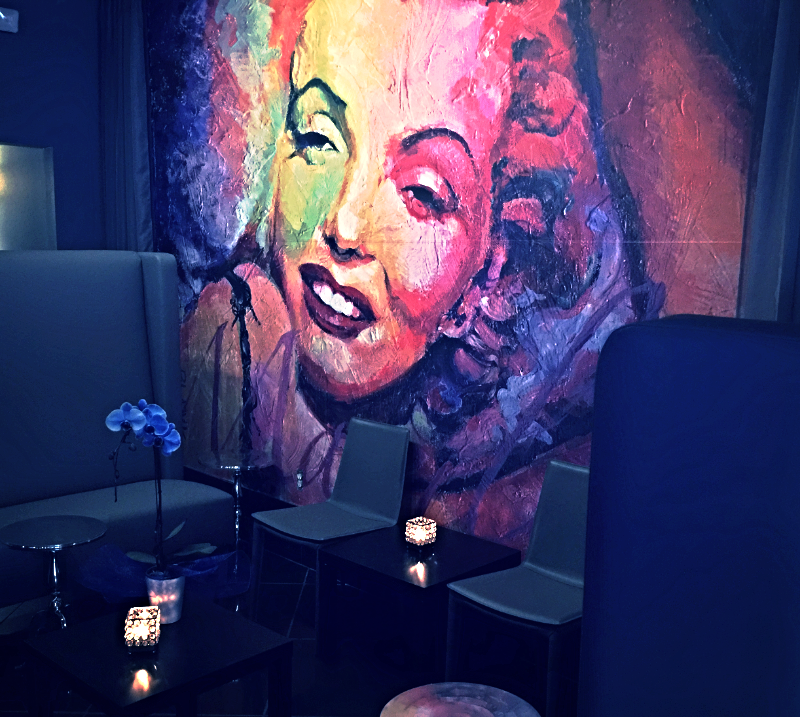 A vibrant mural of Marylin Monroe pops in the VIP area