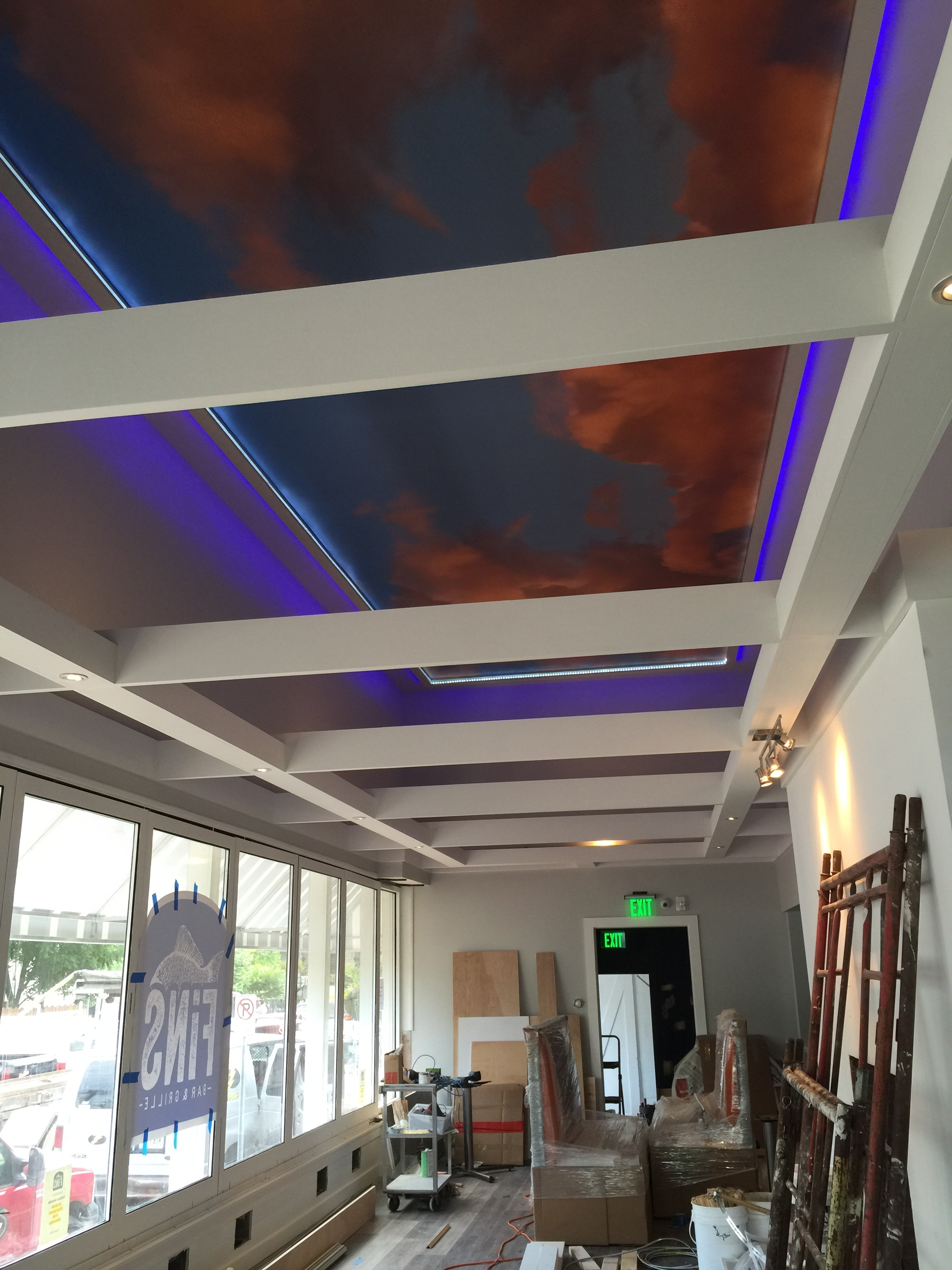 """After"" The upper row of windows was removed during construction and an open ceiling with a floating infrastructure for lighting was created by restaurant designer Raymond Haldeman."