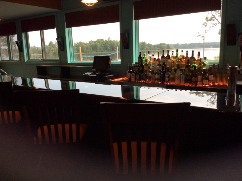 Soft LED lighting cast a glow on the bar front