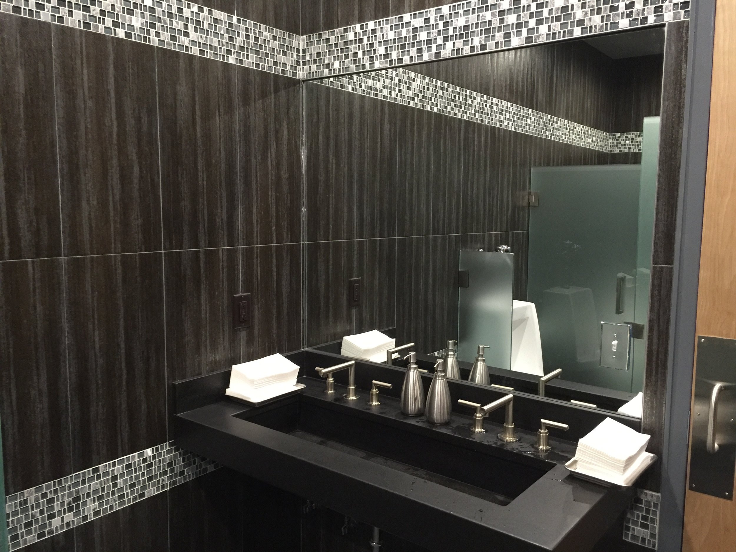 Men's Room with Custom Poured Concrete Trough Sinks