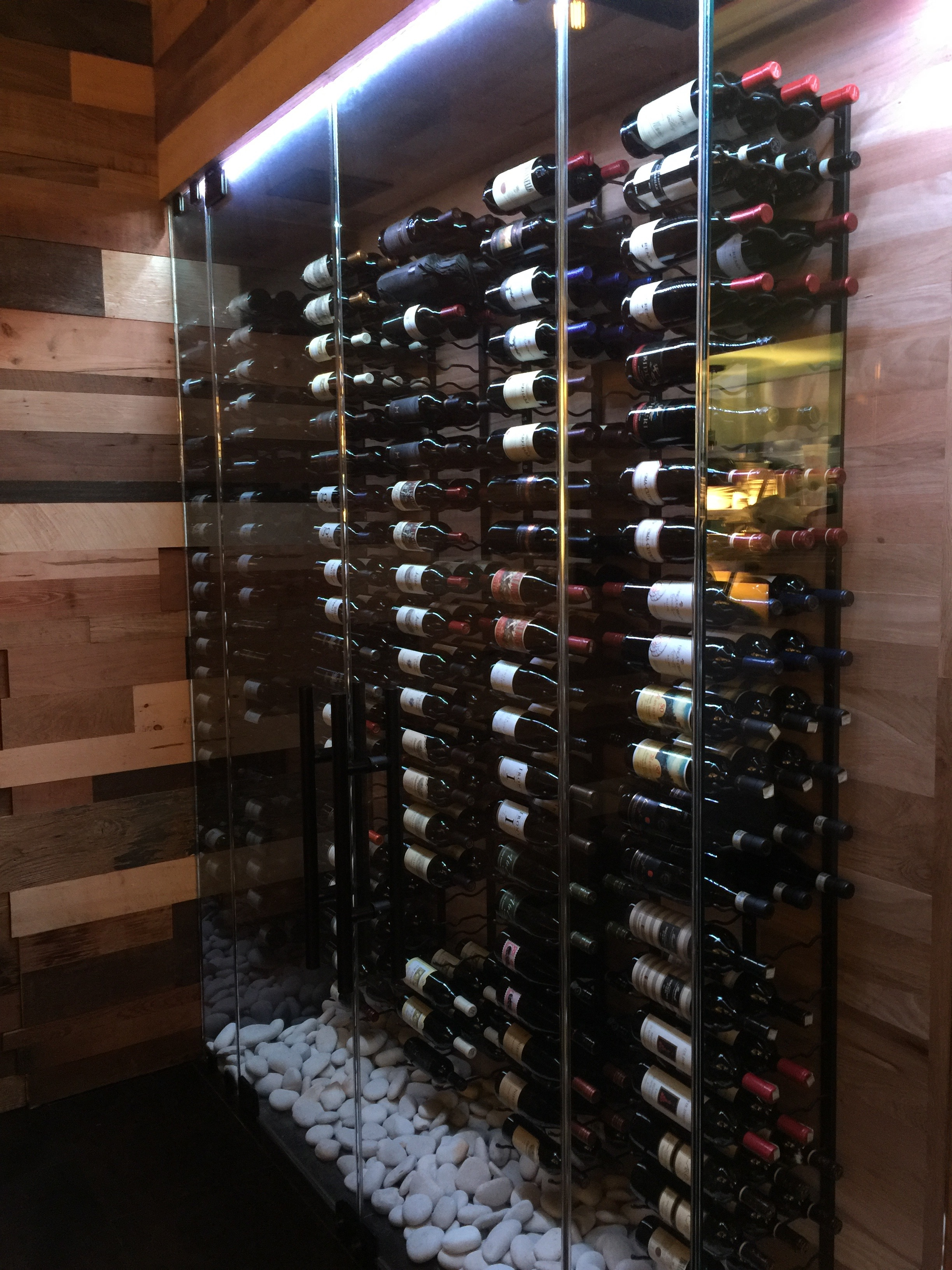 Custom Built Oak Wine Cooler with River Rock