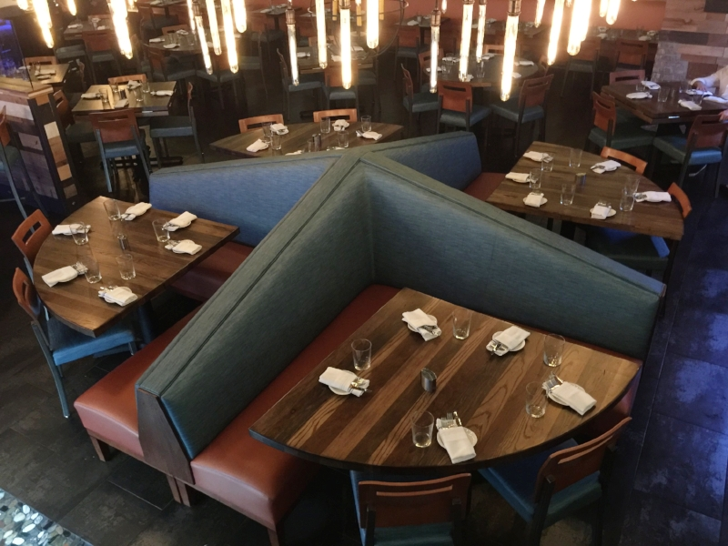Restaurant Designer Raymond Haldeman custom designed this pinwheel banquette as a centerpiece of Cuzin's Dinging Room seating.