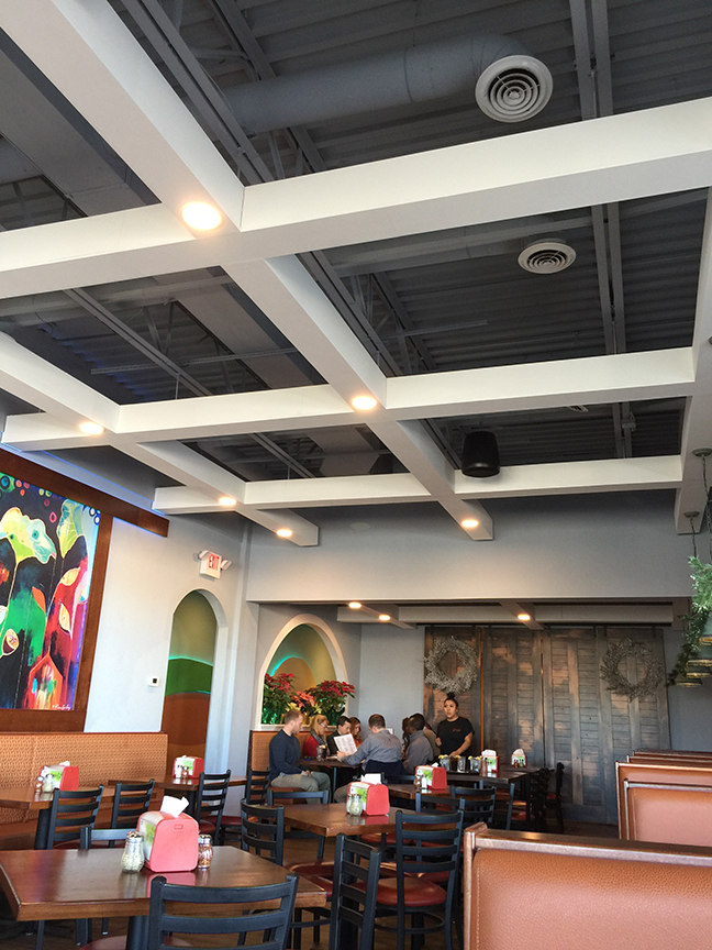 Drop ceiling removed and replaced by architectural gird opened up the space and gave it a more contemporary feel.