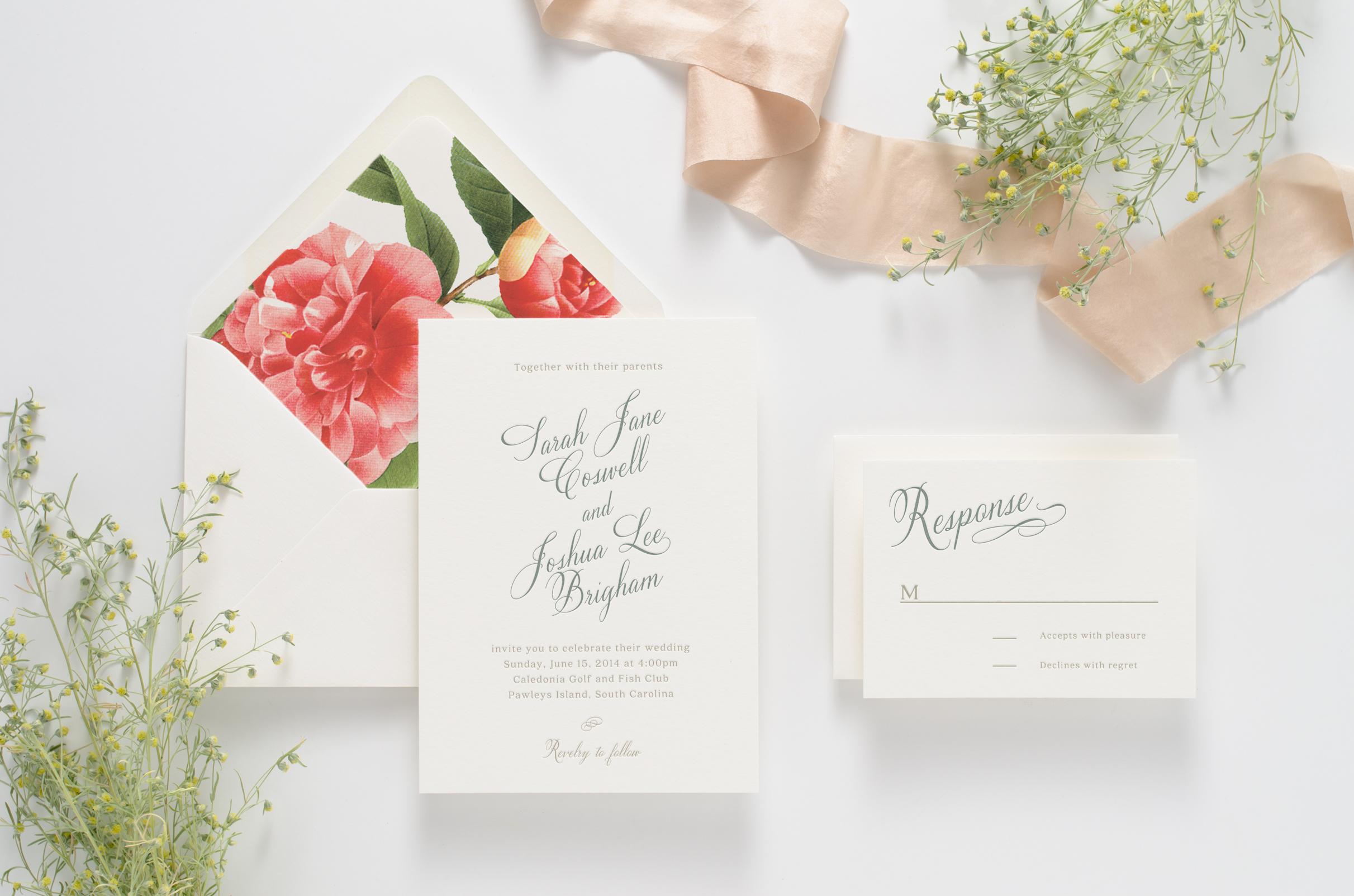 Calligraphy-based letterpress invitation suite with floral envelope liner