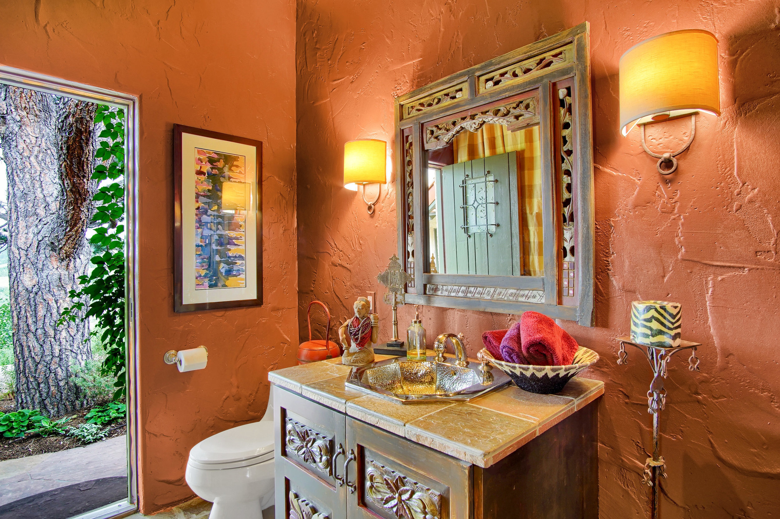 15 - Guest powder room with steam shower and door to back veranda.jpg